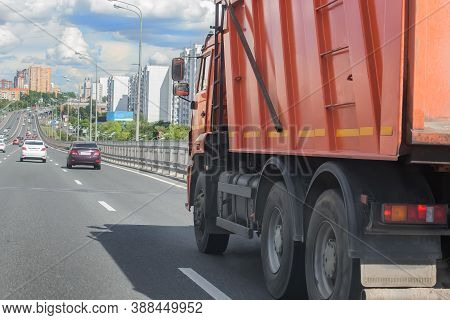 Dump Truck Moving Along The Street In The City