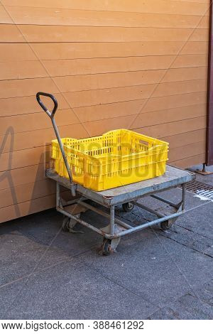 Yellow Plastic Crate At Cart Dolly Transport