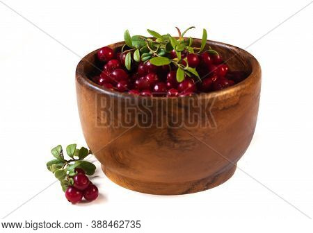 Cranberries In Wooden Bowl Isolated On Withe Background