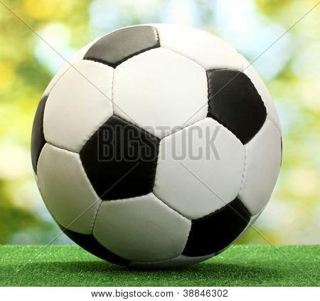 football ball on artificial green grass
