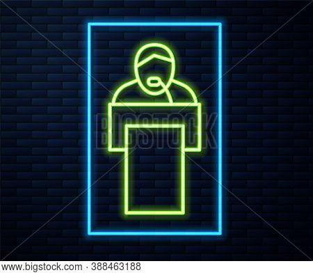 Glowing Neon Line Gives Lecture Icon Isolated On Brick Wall Background. Stand Near Podium. Speak Int