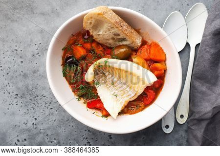 Delicious Fish Stew In Paprika, Tomatoes And White Wine. Cod Fillet White Sea Fish With Organic Vege