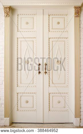 Large White Doors With Forged Handles, Entrance To An Expensive Apartment, Vertical Photo, Place For