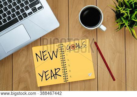 New Year Resolution Goal List 2020 - Business Office Desk With Notebook Written In Handwriting About