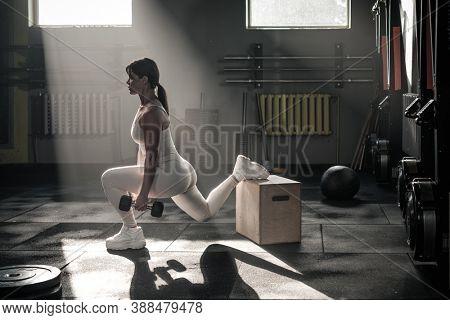 Athlete Female Use Dumbbell For Squat Exercises .