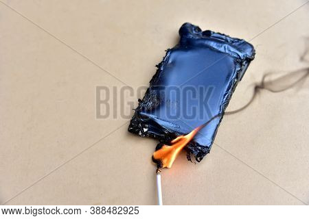 Mobile Phone Caught Fire From The Wire With Recharging From The Electrical Network In The Socket. In