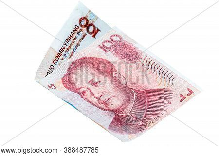 Flying From China Yuan Bank Note On White Background. The Yuan Banknote Is The Main And Popular Asia