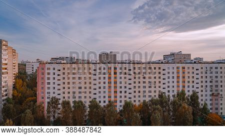 Warm Sunset Over Multi Storey Urban Houses In Moscow City In September. Fall. Trees With Yellowed Le