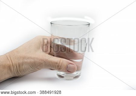 Man Holds A Glass Fill With A Water On A White