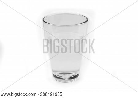 Glass Fill With A Water On A White