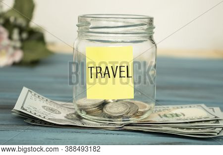 Travel Budget - Vacation Money Savings In A Glass Jar On World Map. Travel Budget Concept. Money Sav