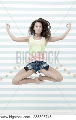 Woman Fit Slim Lady Posing As Meditating While Jump Mid Air. Healthy Lifestyle Keep You In Good Mood
