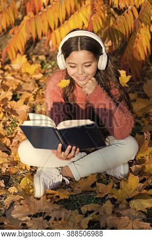 Girl Read Book Autumn Day. Little Child Enjoy Learning At Backyard. Kid Study With Book. Self Educat