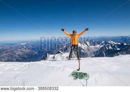 Happy Smiling Rope Team Man With Climbing Axe Dressed Orange Mountaineering Clothes,boots With Cramp