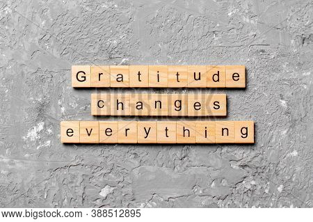 Gratitude Changes Everything Word Written On Wood Block. Gratitude Changes Everything Text On Cement