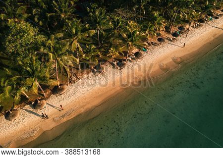 On The Beautiful Beach Of The Island Of Mauritius Along The Coast. Shooting From A Birds Eye View Of