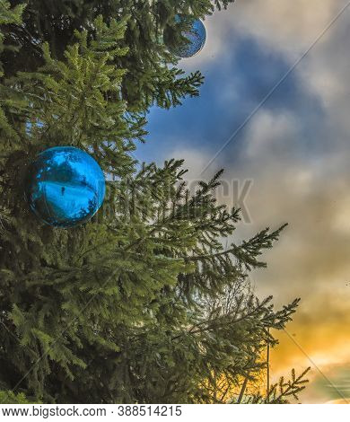 Blue Christmas Ball On Christmas Tree And Sunset
