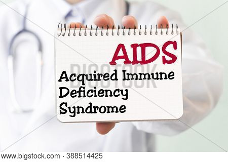 Doctor Writing Word Aids Acquired Immune Deficiency Syndrome With Marker, Medical Concept