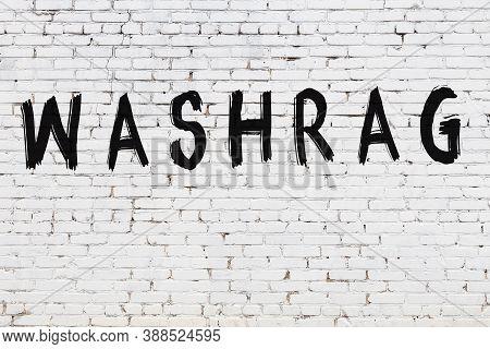 Inscription Washrag Written With Black Paint On White Brick Wall.