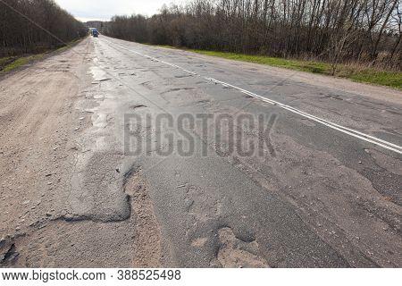 Bad Quality Road With Potholes. Hole In Asphalt, Bad Asphalt. Pit, Unsafe, Hole Road. Transportation