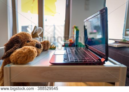Funny Homeoffice Scenery With A Stuffed Teddy And His Friend A Rabbit Working At A Laptop.