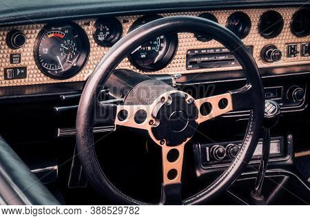 Steering Wheel, Speedometer, Revs, Clock Dials, Radio Scale, Buttons And Knobs On Dashboard And Fron
