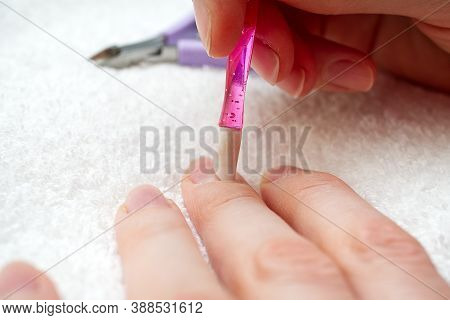 Manicure. Closeup Of A Woman Hand Polishing Nails Manicure. Nail Technician Manicure At Nail Salon.