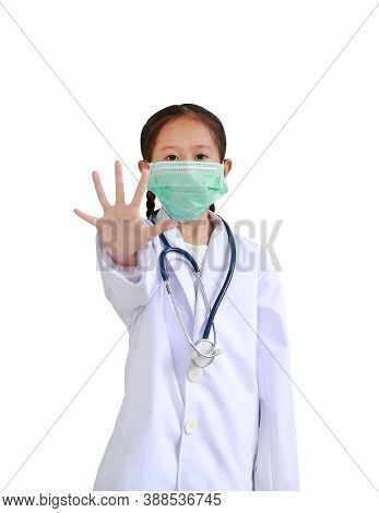 Portrait Asian Little Child Girl Showing Hand Stop Sign Wearing Doctor's Uniform And Medical Mask. K