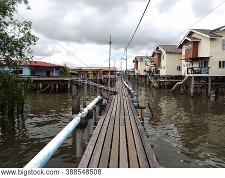 Bandar Seri Begawan, Brunei, January 25, 2017: Wooden Street Built With Cement Beams On The River Of