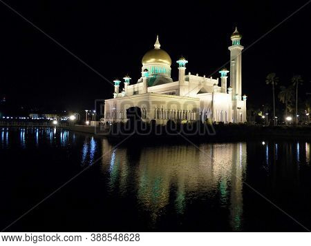 Bandar Seri Begawan, Brunei, January 27, 2017: Reflections In The Water Of The Lake Of The Sultan Om