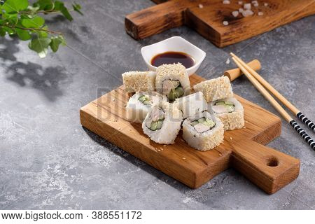 Roll Made Of Fresh Cucumber And Chicken And Salad Inside In A Gray Background. Delicious Food. Beaut