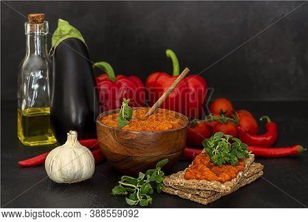 Traditional Autumn Balkan Vegan Caviar Ajvar Or Aivar With Ingredients. Homemade Relish.