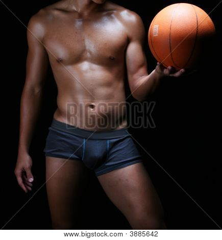 front view of a hunky asian basketball player with a ball in his left hand poster