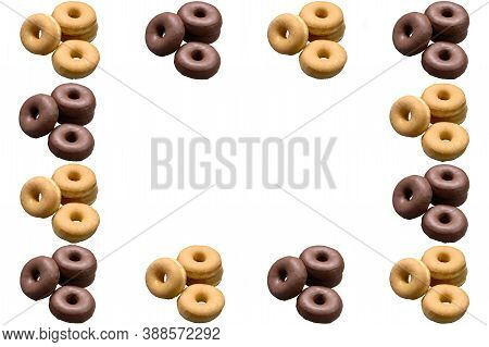 Repetition Of Classic And Chocolate Doughnuts On A White Background. Copy Space. Concept Publicity,