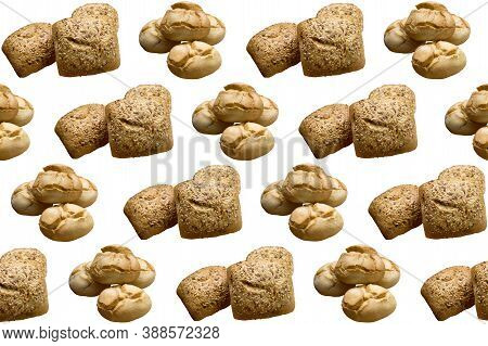 Repetition Of Seeded Rolls On A White Background. Copy Space. Concept Publicity, Food.