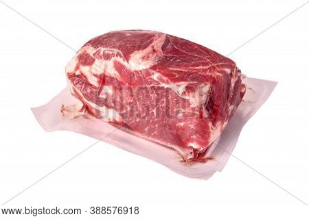 Pork Vacuum-packed In Polythene, Isolated On White Background.