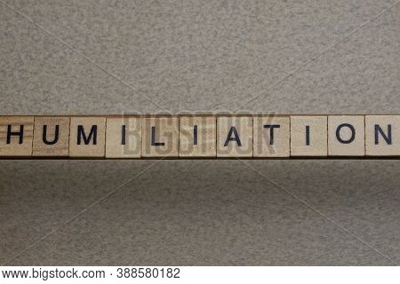 Word Humiliation Made Of Wooden Square Letters On Gray Background
