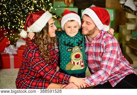 Happy Holidays. Spend Time With Family. Parents And Child Christmas Eve. Christmas Tradition. Father
