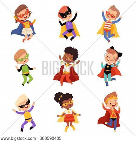 Set With Cute Kids Superheroes. Joyful Guys In Superhero Costumes Jump And Laugh