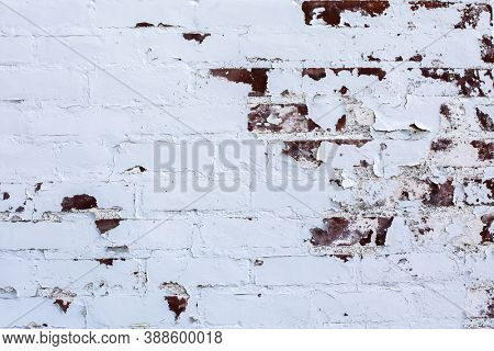 Pealing whgite paint from brick wall background