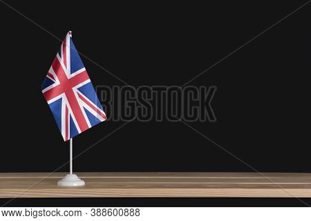 National Table Flag Of Uk On Black Background. Uk Flag. Britain.