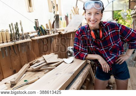 Young Beautiful Handy Professional Happy Female Strong Carpenter Portrait Wearing Protective Goggles