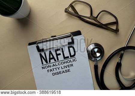 Nafld - Non-alcoholic Fatty Liver Disease Write On A Paperwork Isolated On Office Desk.