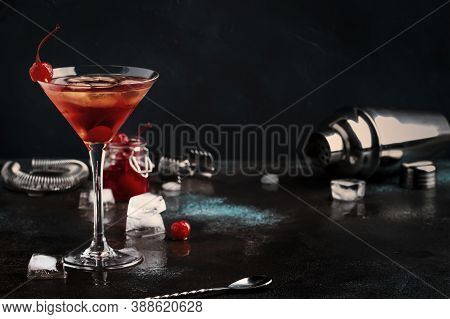 Manhattan Alcoholic Cocktail With Bourbon, Red Vemuth, Bitter, Ice And Cocktail Cherry In Glass, Nig