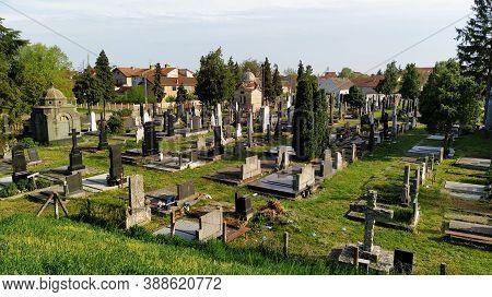 Sremska Mitrovica, Serbia, April 21, 2020. Catholic Cemetery, Aerial View. Stone Crosses And Graves.