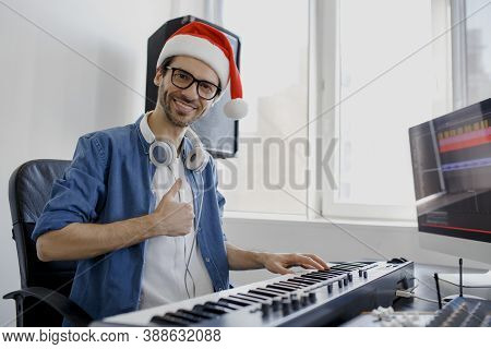 Thumb Up. Merry Christmas And A Happy New Year Composer Hands On Piano Keys In Recording Studio. Mus
