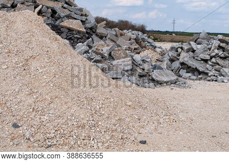 Heaps Of Gravel And Damaged Rubble At A Road Construction Site