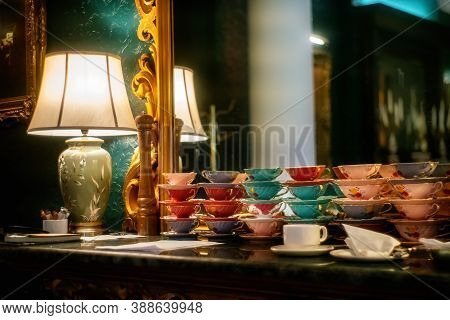 Colorful Cups And Lamp On The Table At The Mirror.close View.