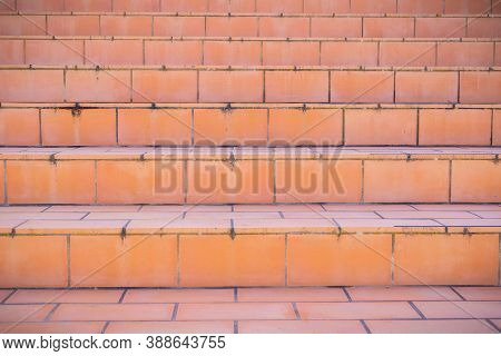 Close-up Of An Orange Tiled Exterior Staircase In Front Of The Entrance To A House