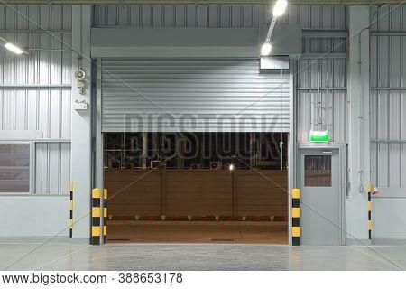 Roller Door Or Roller Shutter Using For Factory, Warehouse Or Hangar. Industrial Building Interior C
